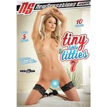 Blonde female posed nude on knees in bed